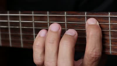 left-hand-clamps-the-strings-on-the-guitar